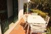 Appartamento al piano terra con ampio giardino in contesto turistico