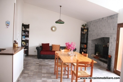 Renovated apartment with fireplace and large terrace